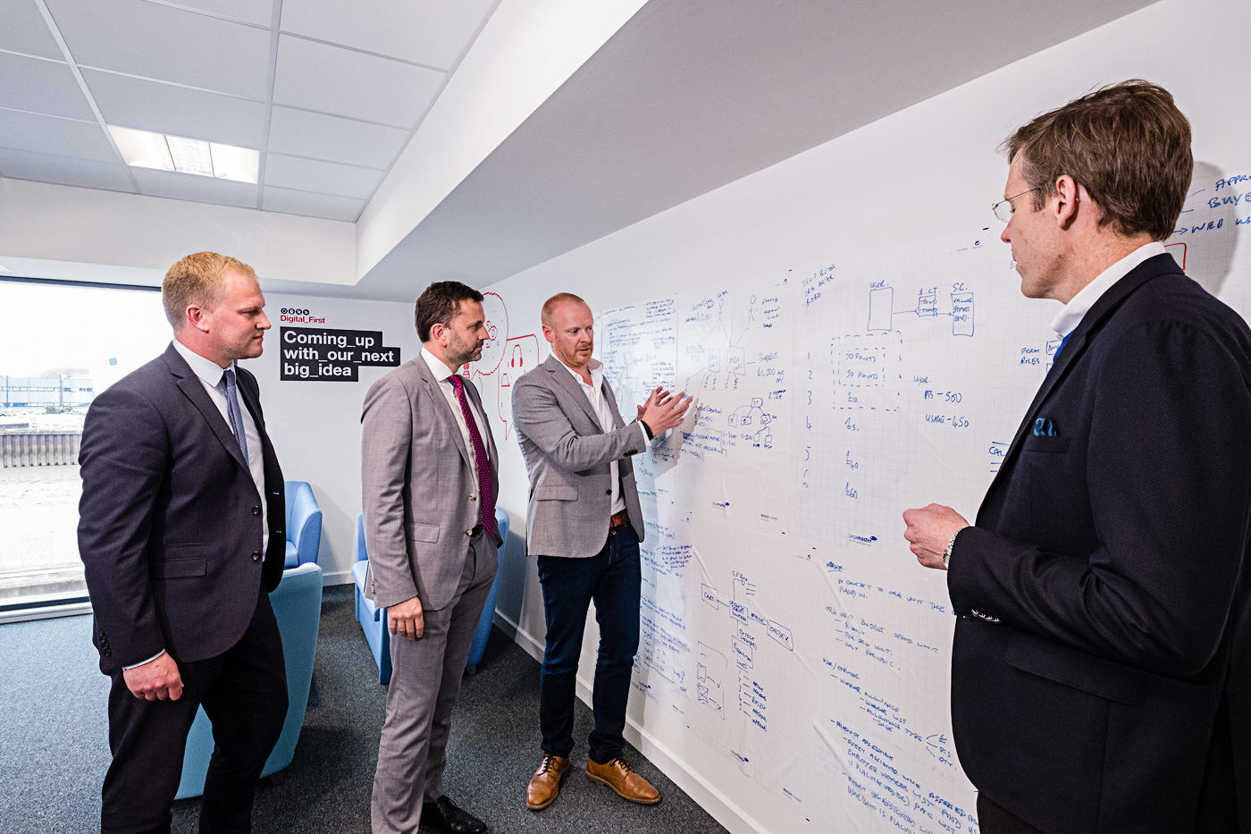 Arco's Digital Director Richard Martin explains the company's Digital First programme to Wykeland Group's Dominic Gibbons and John Gouldthorp, left, watched by Arco Chief Executive Neil Jowsey