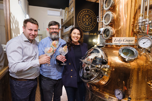 Owners Lee Kirman and Charlotte Bailey with Master Distiller Jamie Baxter, centre, toast the launch of the Humber Street Distillery Co. still and their Hull Dry Gin.