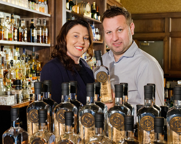 Humber Street Distillery Co. owners Charlotte Bailey and Lee Kirman with bottles of their in-house distilled Hull Dry Gin.