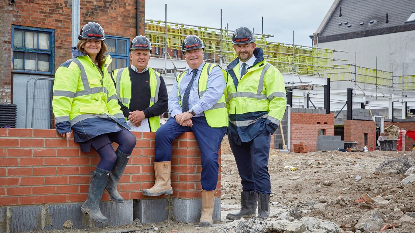 From left, Beal Homes Sales and Marketing Director Sue Waudby, Site Manager John Ellis, Construction Director John Goodfellow and Chairman and Managing Director Richard Beal at Wykeland Beal's residential development site in Hull's Fruit Market.