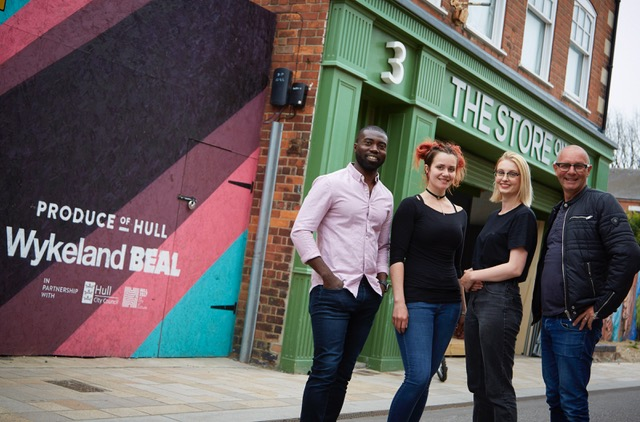 Owners Phil Benson, left, and Jonathan Elvidge with Manager Katherine Gregory, second left, and Sales Assistant Beth Hall outside The Store on Pier Street in Hull's Fruit Market waterfront quarter.