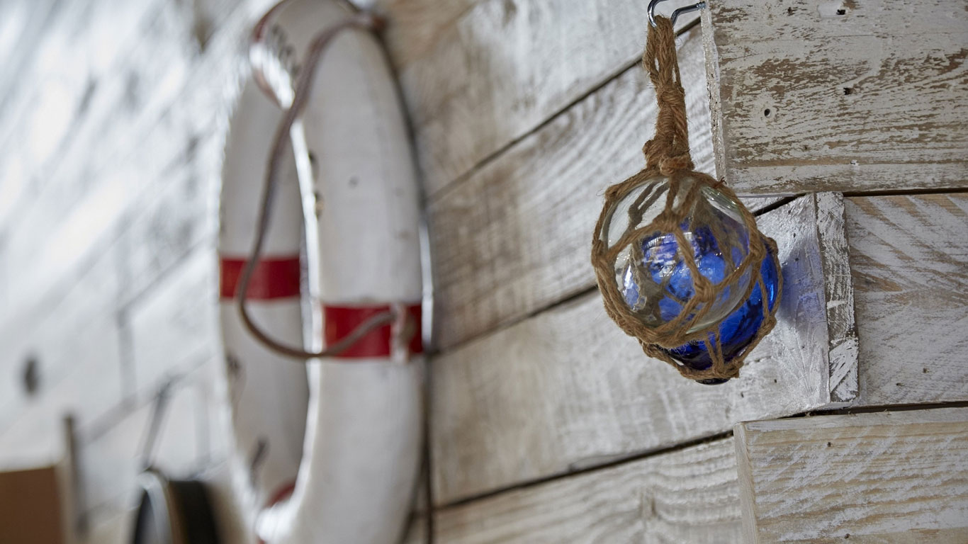 The décor of Humber Fish Co features nautical artefacts, including an antique diving helmet, life belts and lights salvaged from a Japanese trawler.