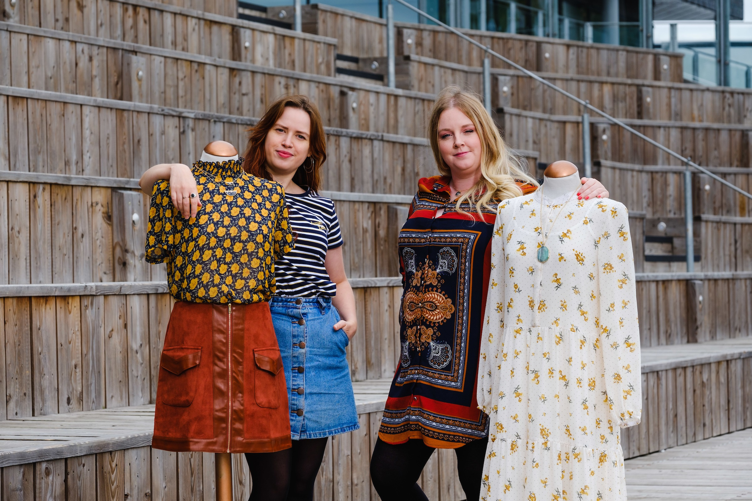 Owner Nicola Gibbons, right, and Manager Anna Carter pictured at the Stage @TheDock venue in the Fruit Market with examples of the fashions that will be stocked when Tessies opens in the thriving waterside quarter.
