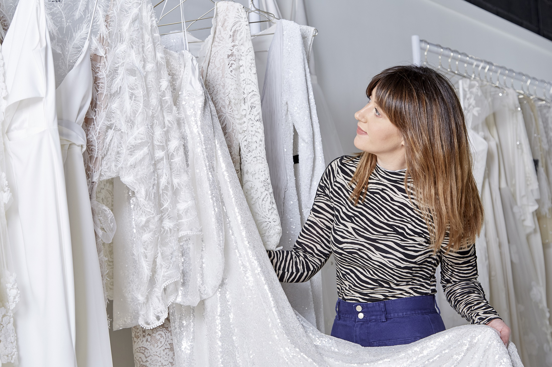 The bridal boutique features dresses by top bridal designers such as Alexandra Grecco; Daughters of Simone; And For Love; and Chantel Lauren.