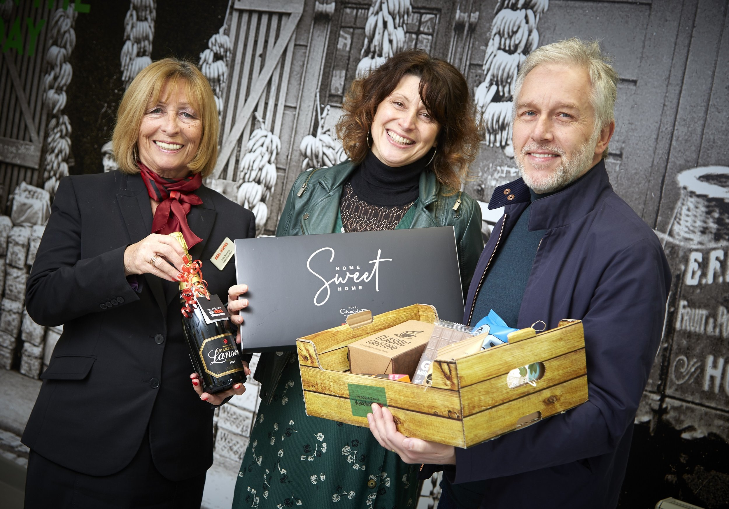 The first residents of the new Fruit Market community, Steve Copeman and Claire Bell, with a welcome hamper to celebrate moving into their new property.