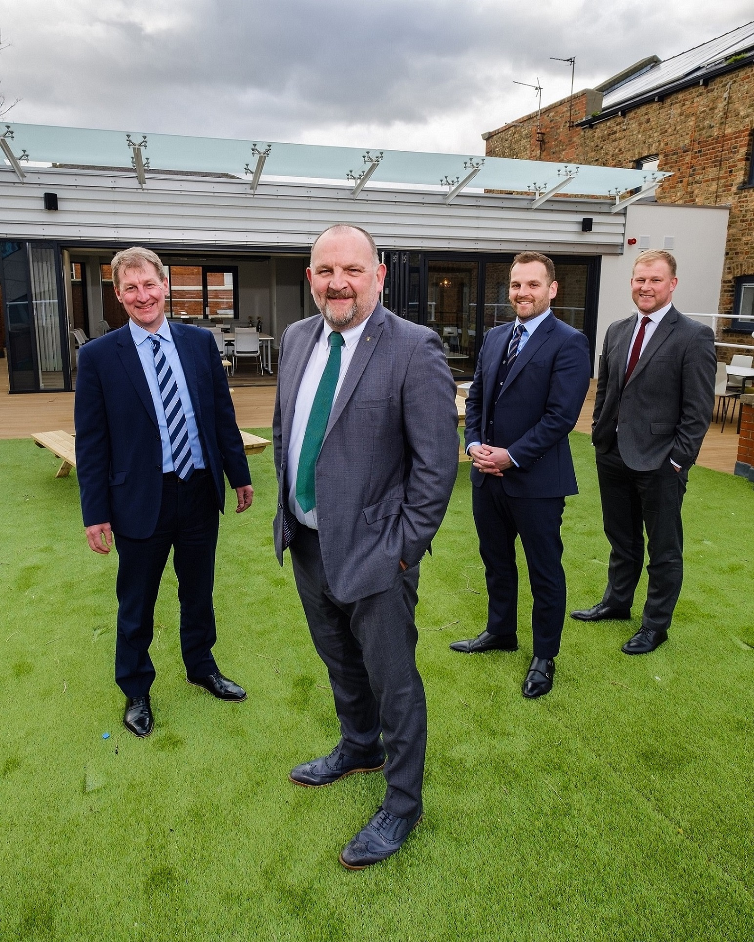 "From left, Wykeland's David Donkin, Hugh Rice's Mike Rice and James Rice, and Wykeland's John Gouldthorp outside the new rooftoop ""pod"" - a key feature of Hugh Rice's new Central Support Unit."