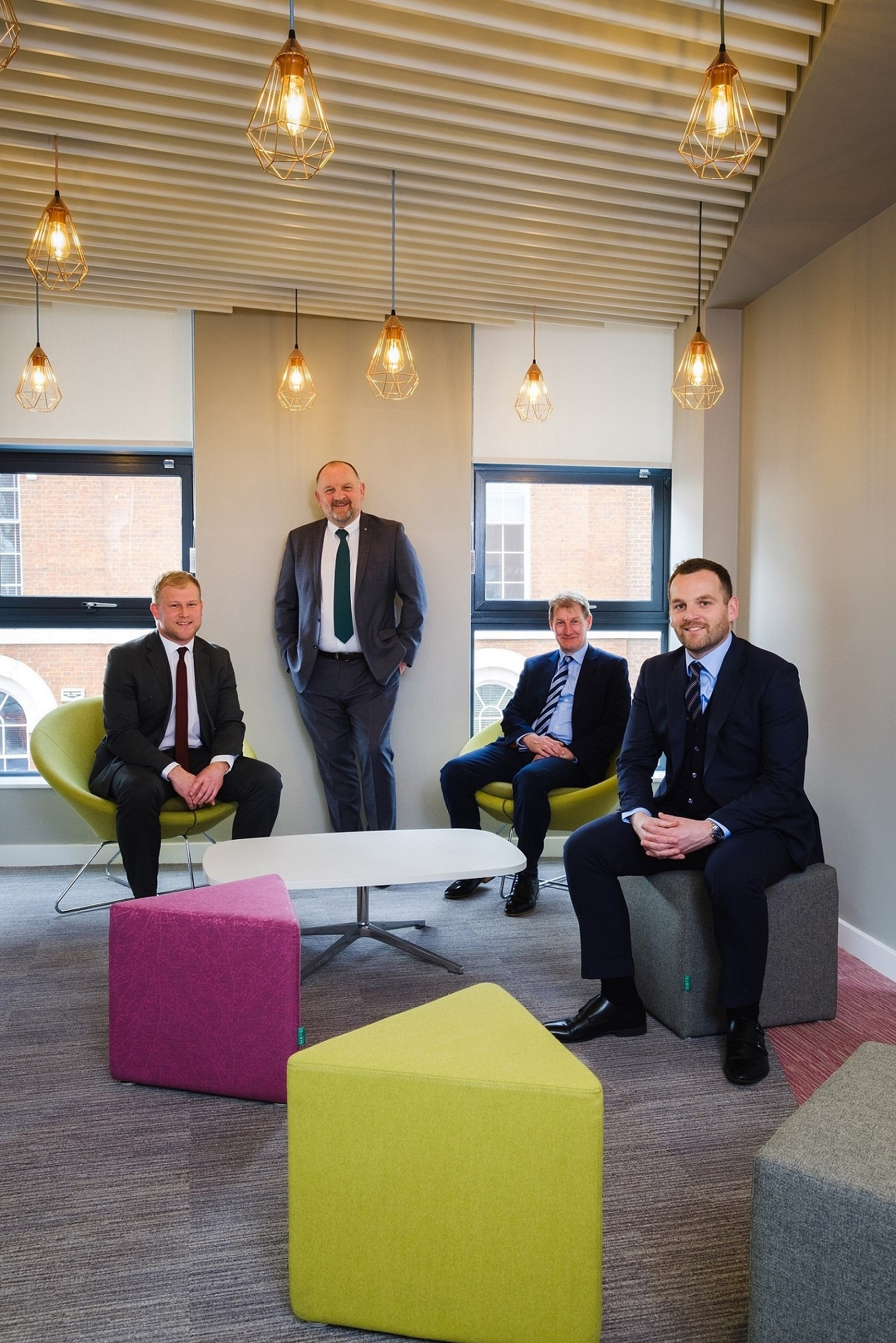 From left, Wykeland's John Gouldthorp, Mike Rice, David Donkin of Wykeland, and James Rice in the colourful new Hugh Rice offices in Hull's Fruit Market waterfront quarter.
