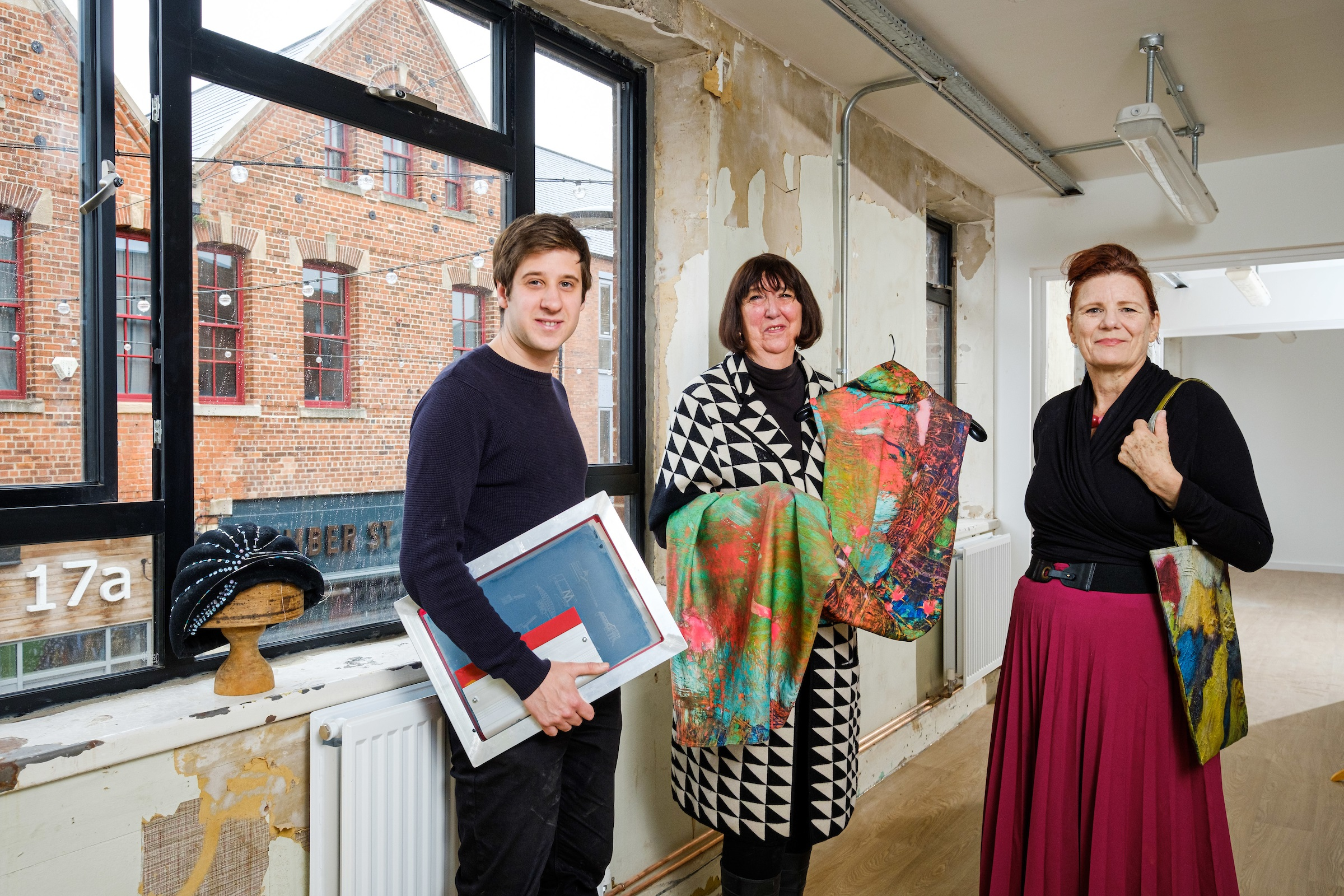 Joseph Cox, owner of Form Shop & Studio, left, with Lynn Benson and Annemarie Tickle of Feral Art School, one of the first organisations to join the Juice Studios community, inside the creative space.