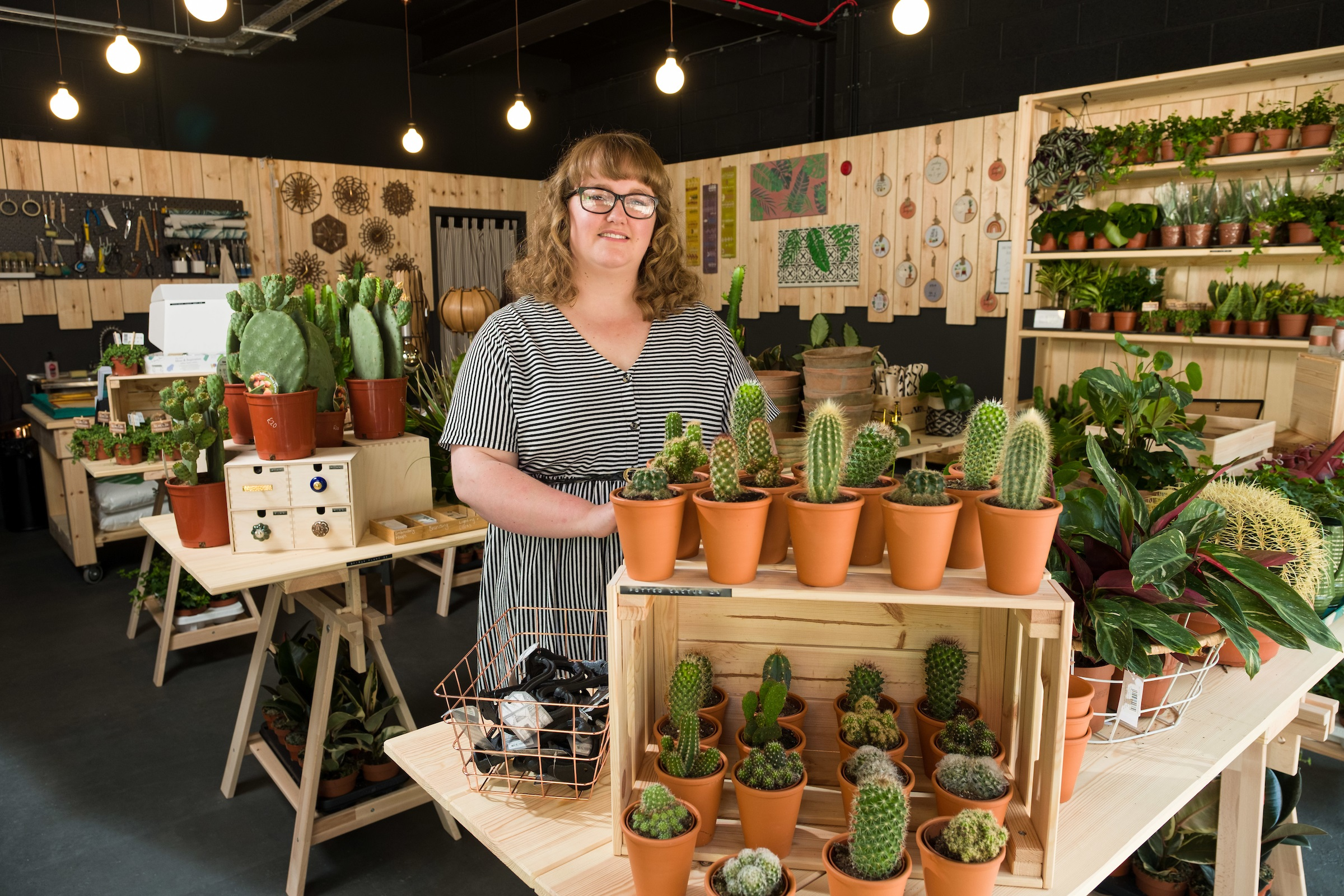 Lara Roberts in her new furniture, homewares and house plants shop, Plant & Paint, which has opened in Hull's Fruit Market urban village.