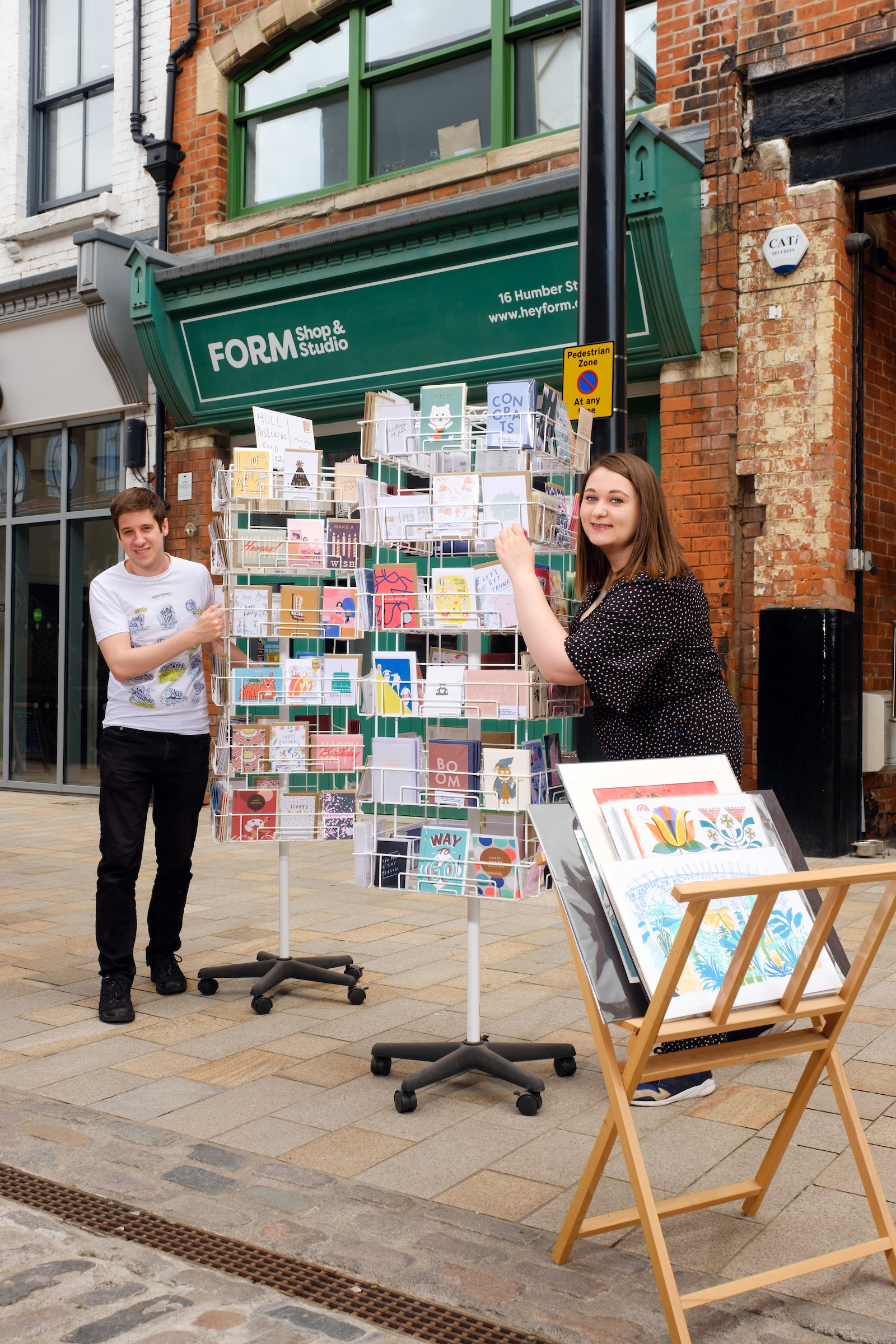 Joseph and Alice outside their current shop on Humber Street.