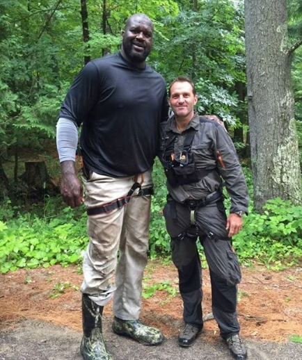 Dave keeping Shaquille O'Neil safe for a show for NBC.