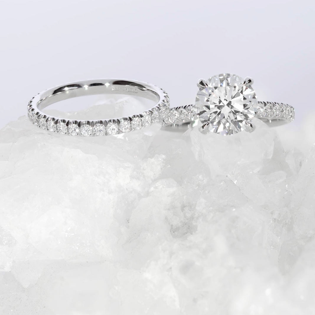 The  Bardot Scallop engagement ring  and matching  Scallop Set wedding ring , by Queensmith