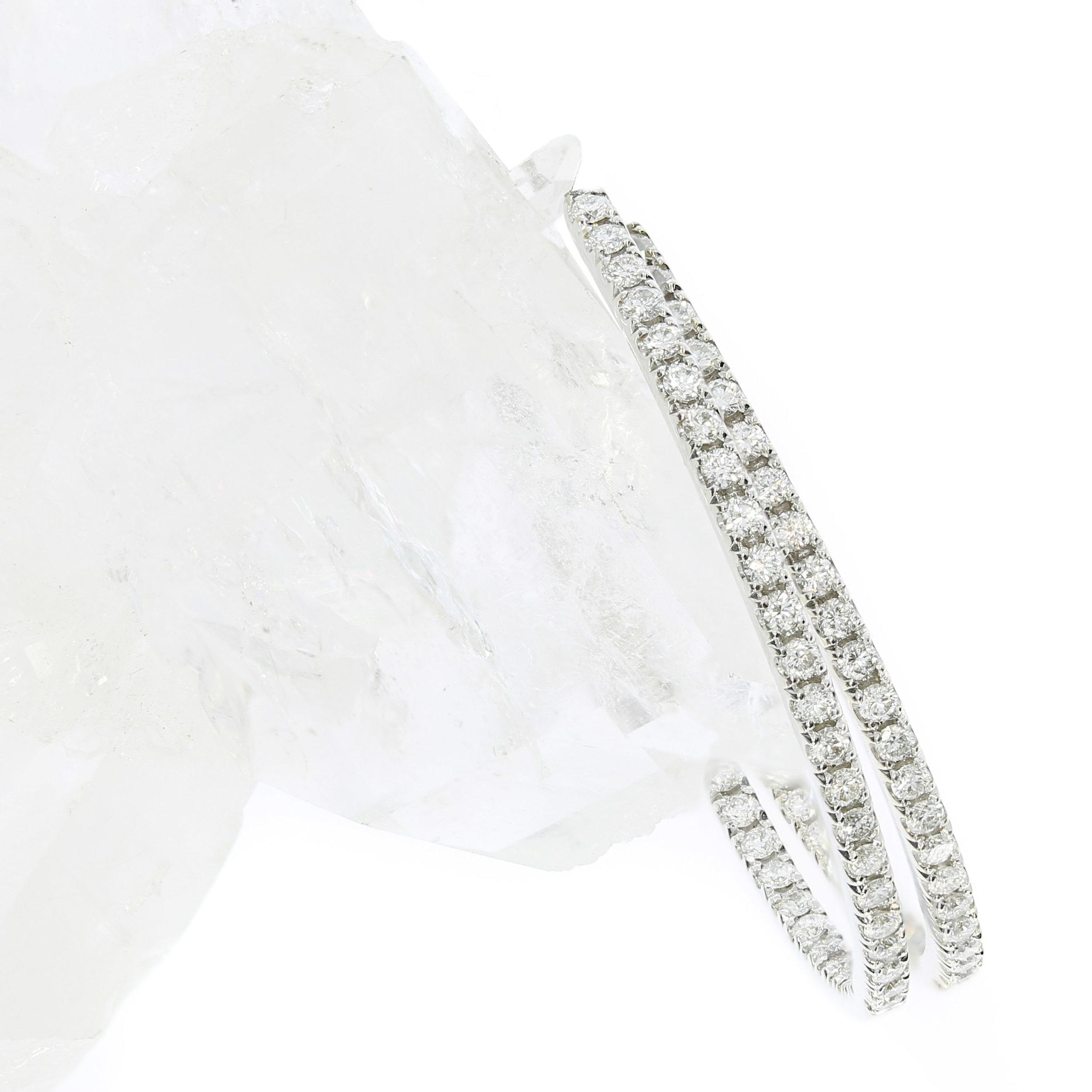A pair of diamond hoop earrings, created by Queensmith