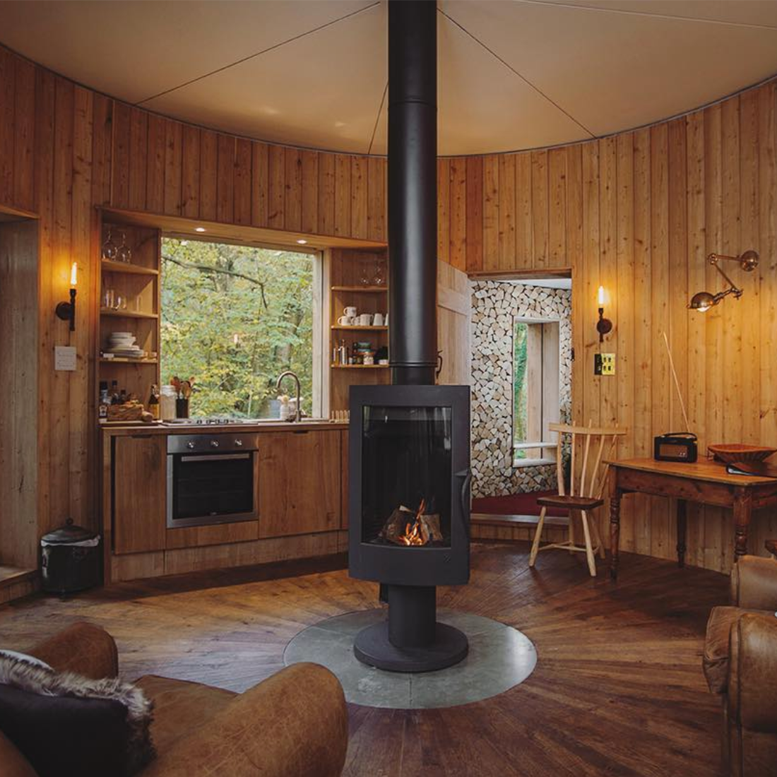 The cosy interior, complete with wood burner  @craftycamping