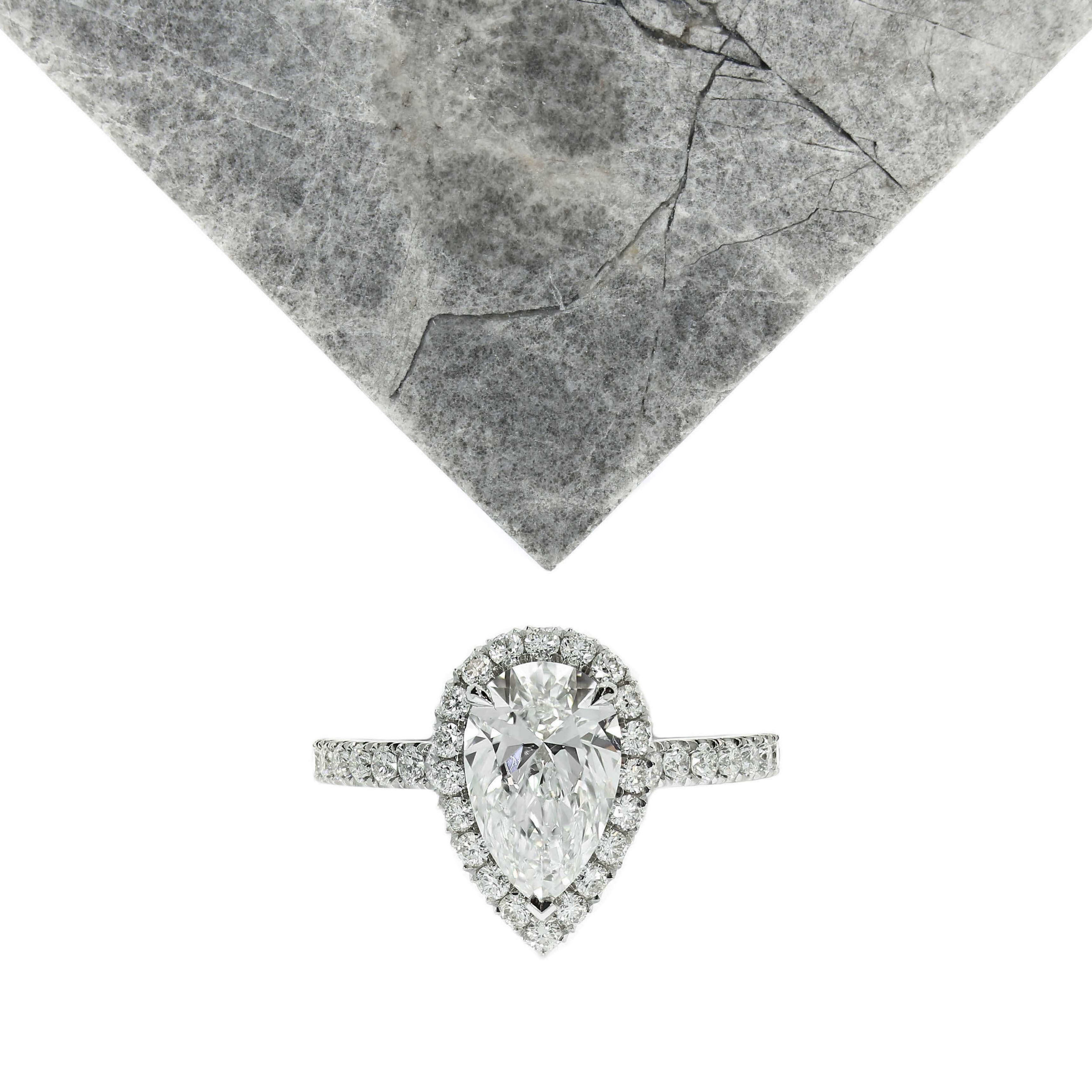 A pear halo and diamond set band is a timeless choice