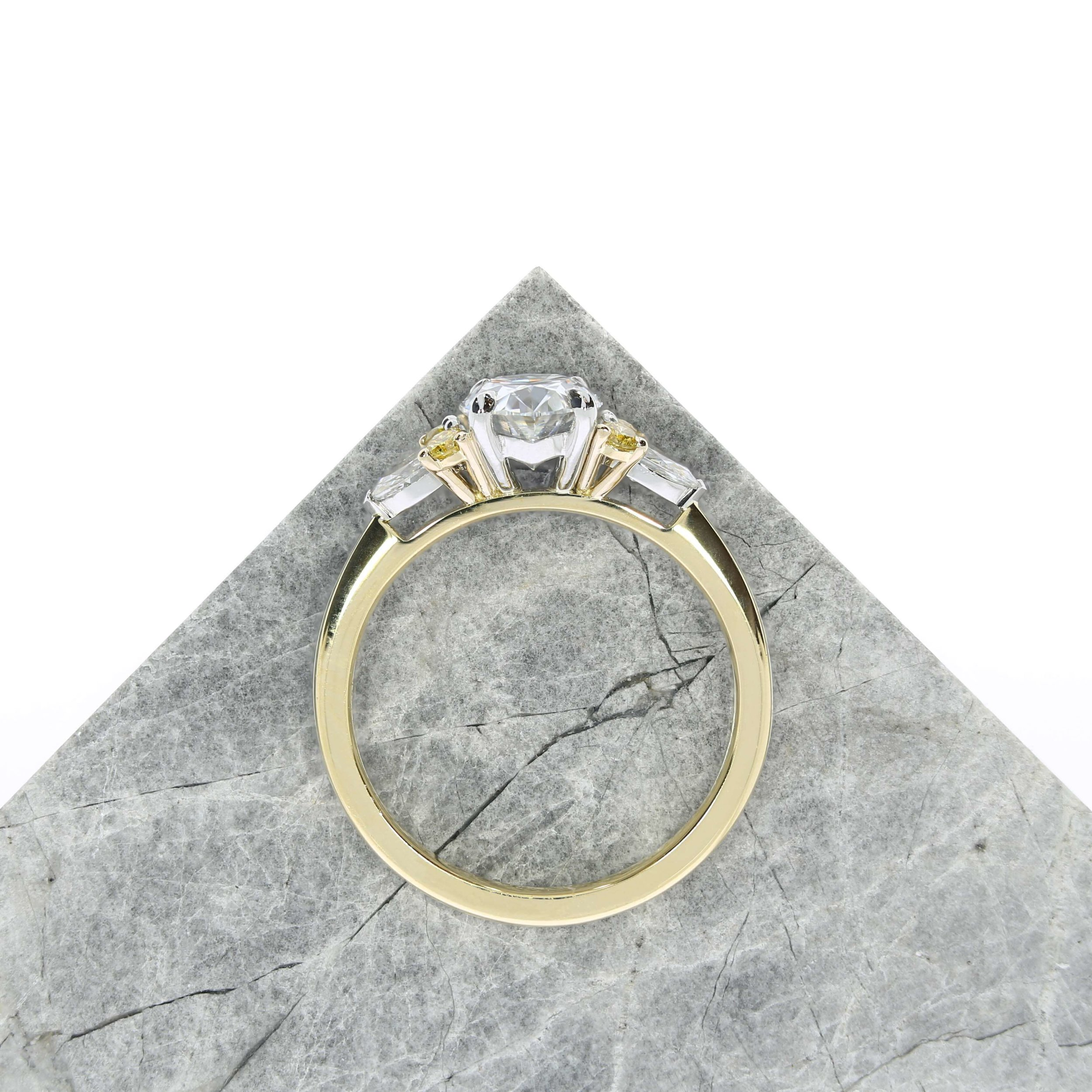 If you know your partner has a favourite colour, why not add some stones to match it? This creative design features white and yellow diamonds