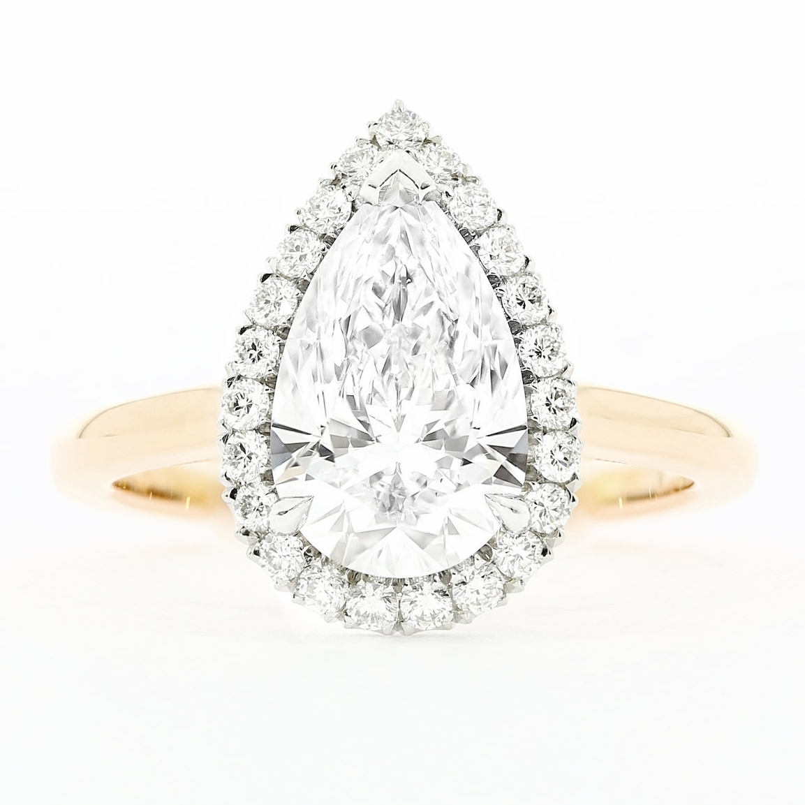proposal-stories-ideas-pear-diamond-halo-rose-gold-engagement-ring-amazing-romantic-story-australia-beach-engagement-wedding-queensmith-master-jewellers-hatton-garden-london