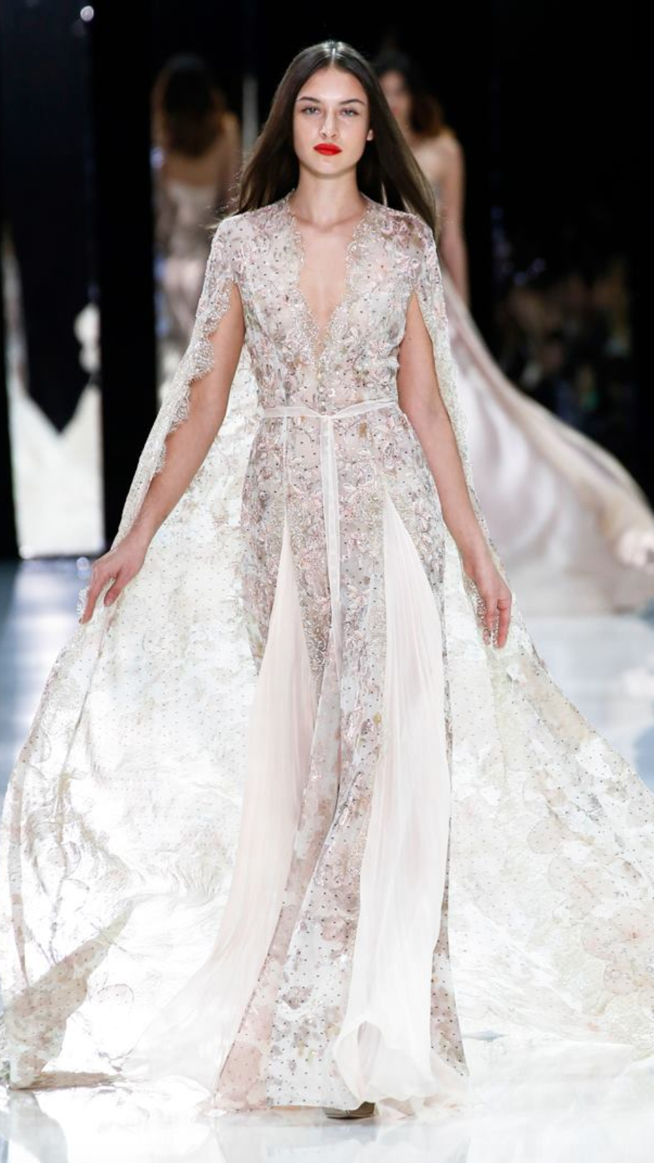 Our money's on a wedding dress cape by Ralph & Russo.  ralphandrusso/Facebook