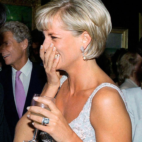 Princess Diana pictured wearing the aquamarine ring Harry gifted Meghan