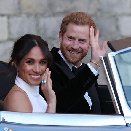 Meghan flashes her aquamarine cocktail ring, and she and Harry drive to their wedding reception