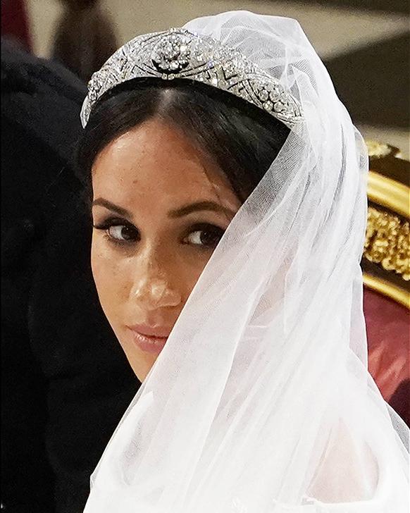 Queen Elizabeth lent Meghan a striking Art Deco tiara to wear on her wedding day.  PA