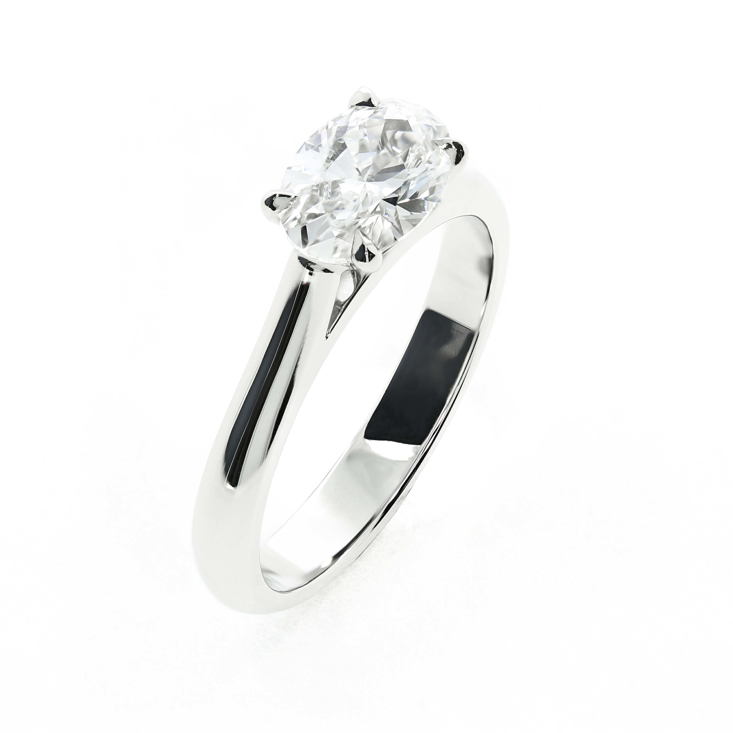 This bespoke engagement ring by Queensmith uses a thick band and horizontally set oval diamond for a neutral look
