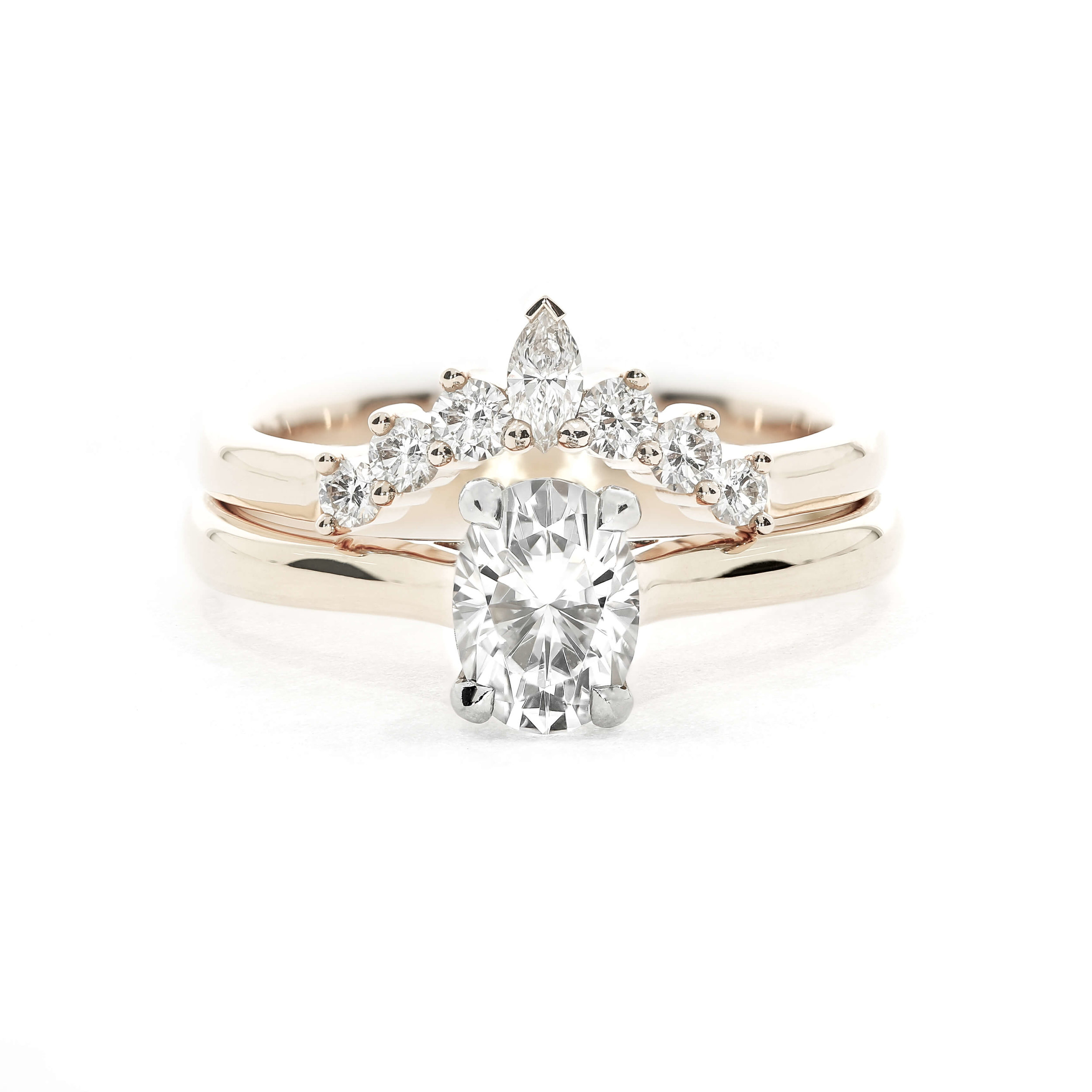At Queensmith, we love to add a bit of sparkle to solitaire engagement rings with diamond wedding bands
