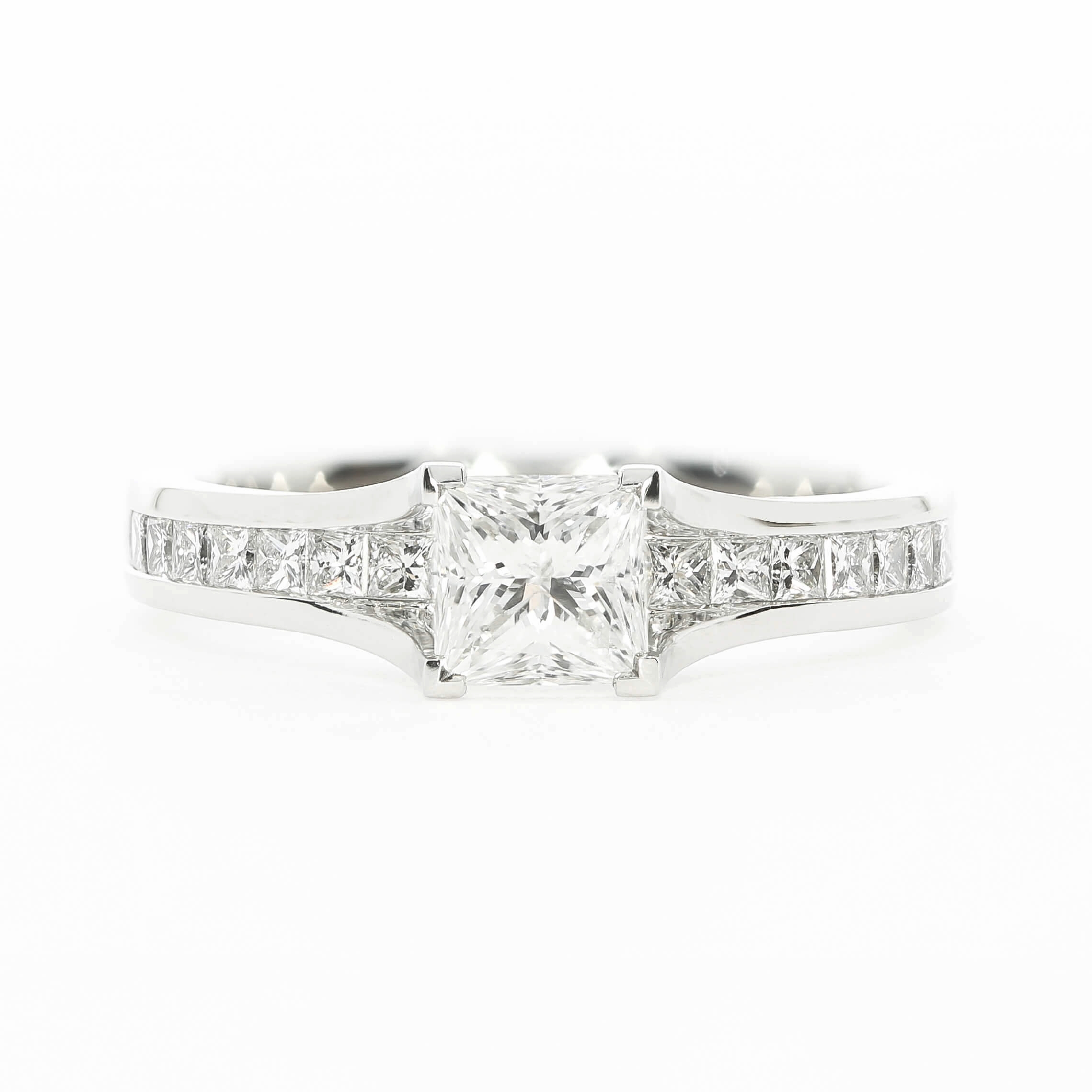This bespoke engagement ring uses a princess cut channel set diamond band with a princess cut centre diamond