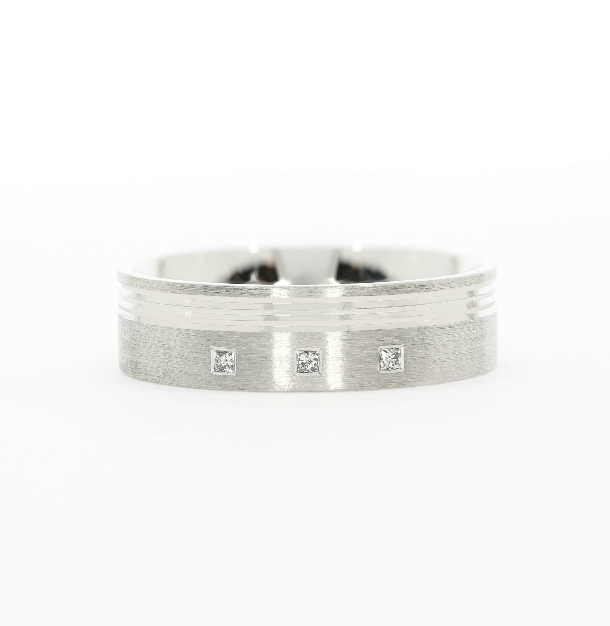 Adding diamonds to a thick band is a great way to add your own personality to a design. Bespoke ring by Queensmith