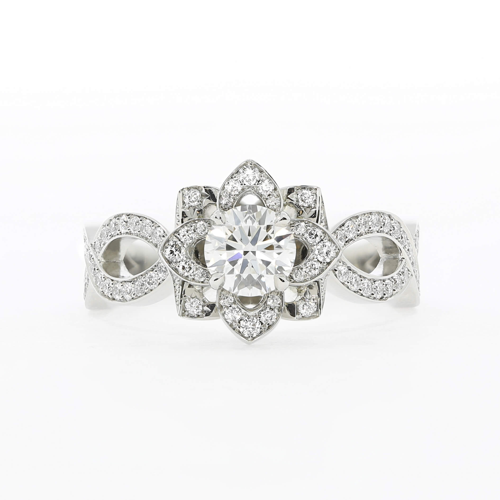 Contemporary flower halo engagement ring, by Queensmith