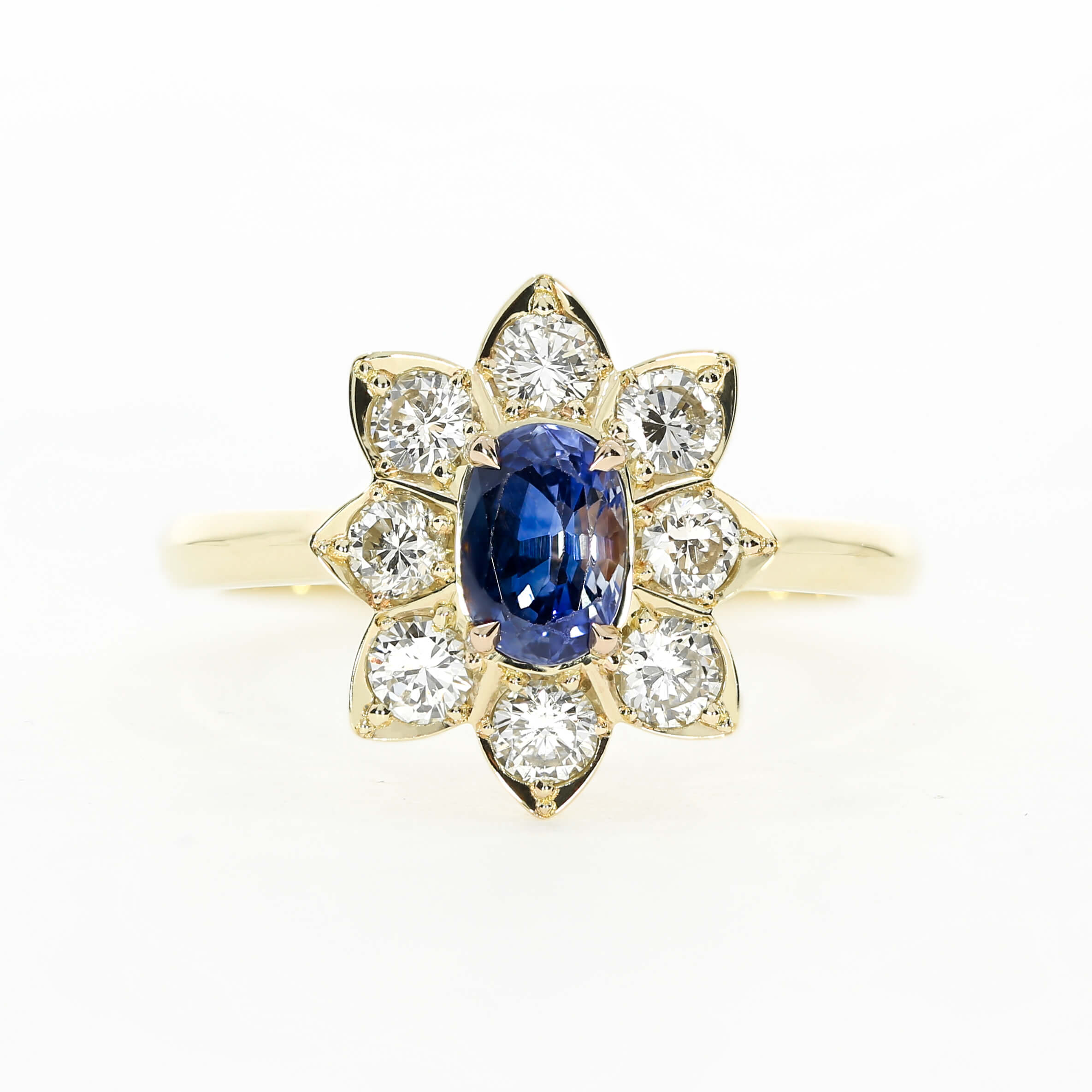 Using a flower halo gives the impression of an antique engagement ring, by Queensmith