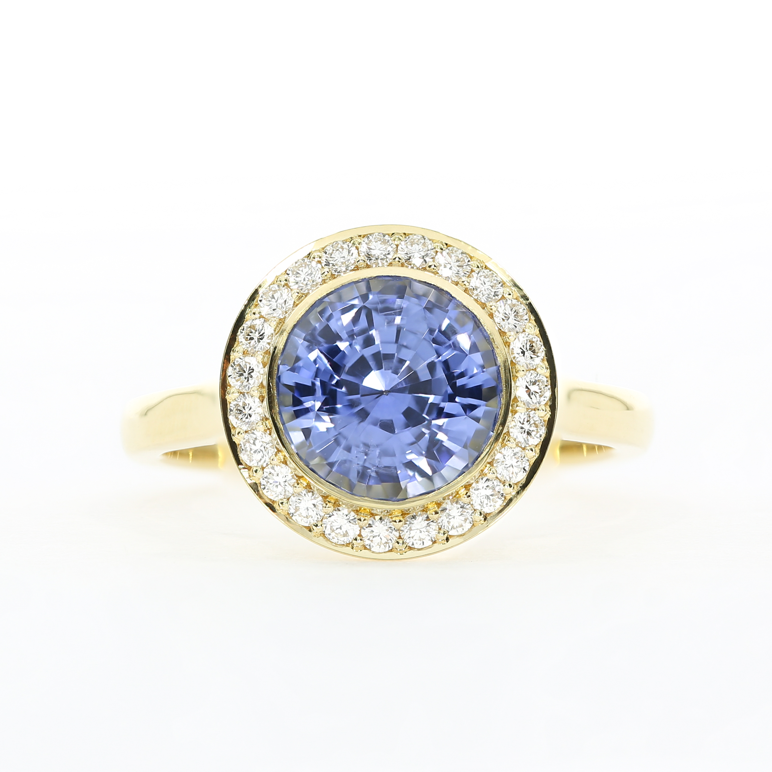 A custom take on the  Faye  engagement ring, using a bold sapphire centre stone