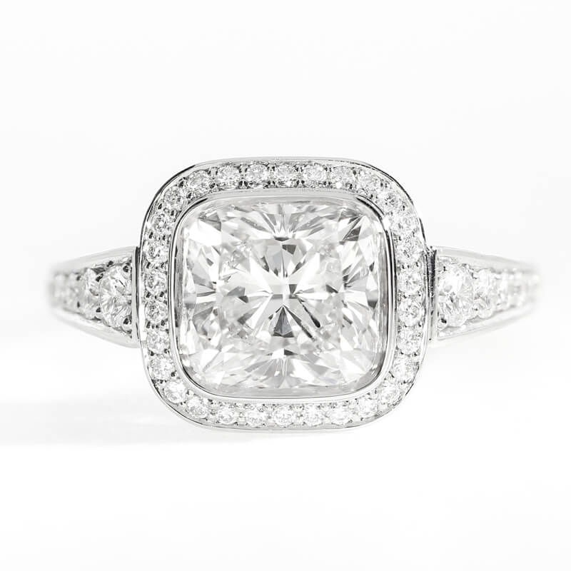 Pavé set cushion cut design, featuring graduated shoulder diamonds