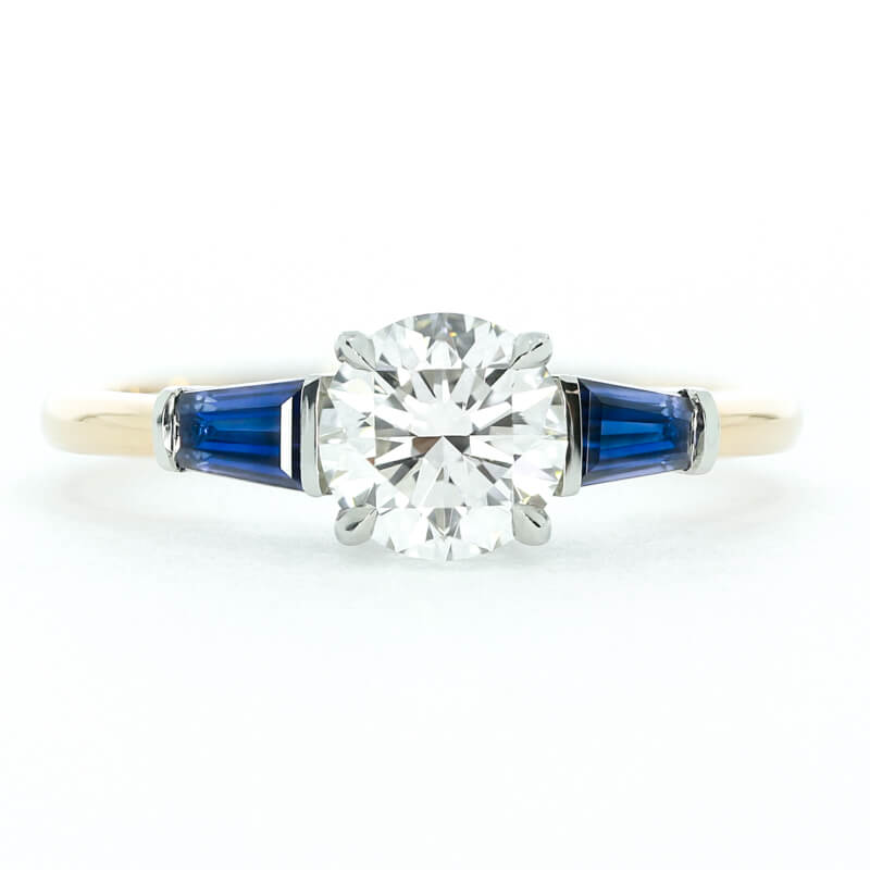 A bespoke take on the  Winters engagement ring , set with baguette sapphires in rose gold
