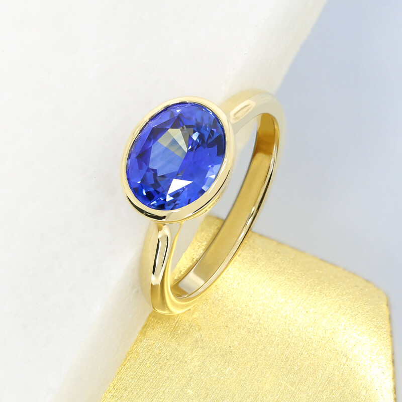 blue-sapphire-yellow-gold-engagement-rings-rubovers-hatton-garden-jewellers-queensmith.jpg