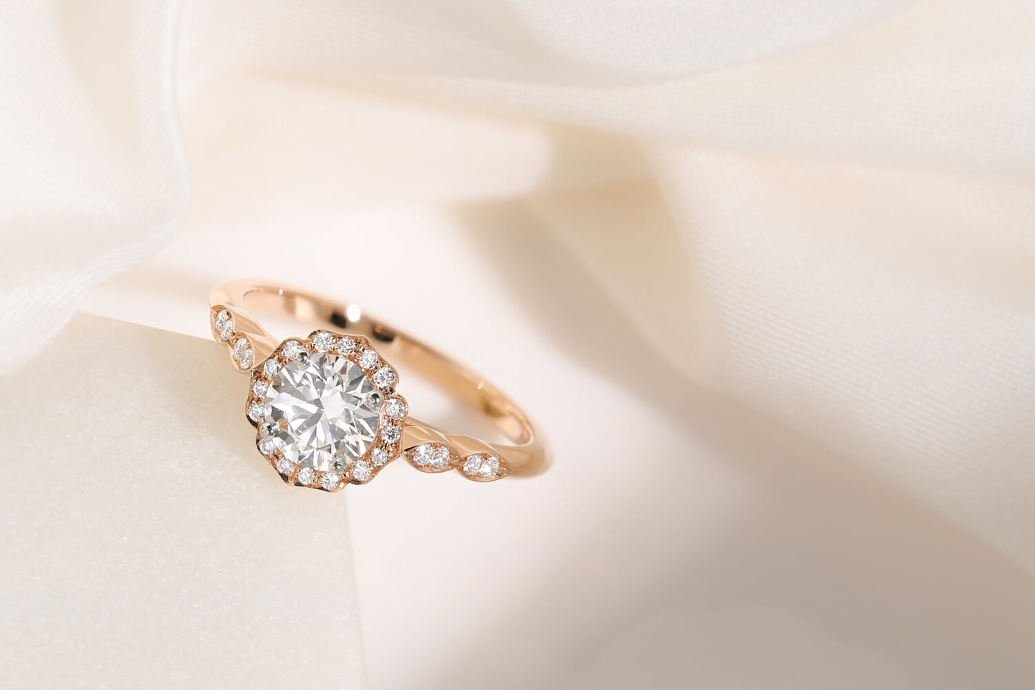 Rose Gold Halo Engagement Rings Hatton Garden London Queensmith Queensmith Master Jewellers