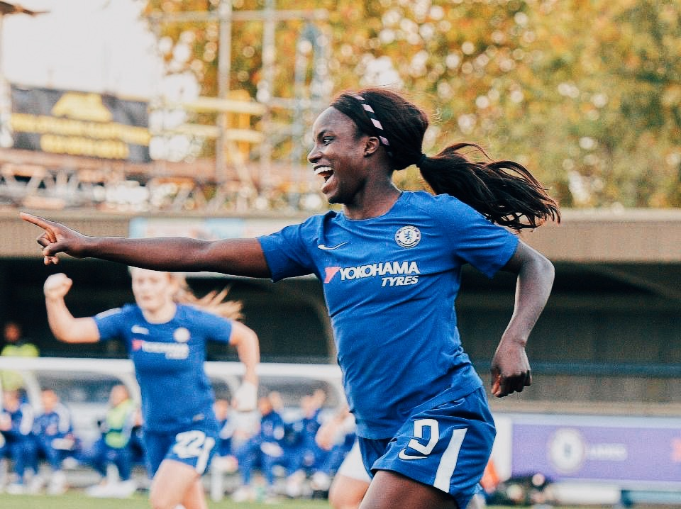 Aluko celebrates her second goal of the match
