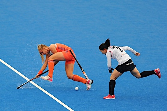 Laurien Leurink of the Netherlands fouled by Su Ji Choi of South Korea Image:Harriet Lander/Getty