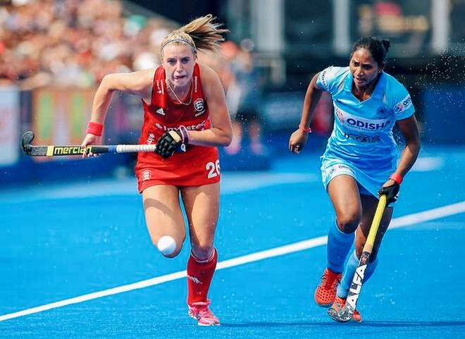 Lily Owsley, left, equalised for England from a penalty corner in the 54th minute. Image via The Hindu