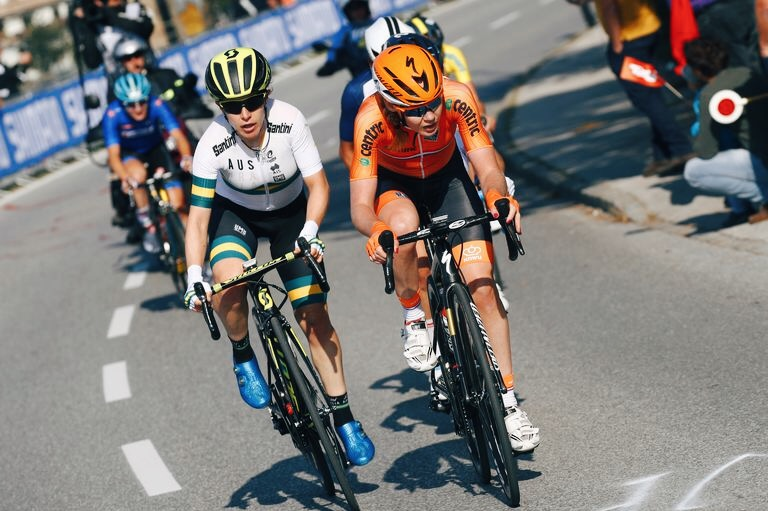 Anna van der Breggen, right, keeps ahead of Amanda Spratt.