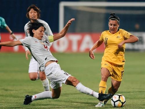 Japan's Saki Kumagai vies with Lisa De Vanna of Australia during the AFC Asian Cup Final in April. Image: Xinhua