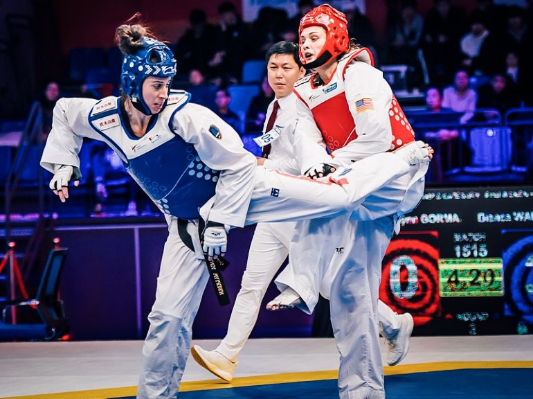 Team GB's Bianca Walkden (left) goes for a spinning back kick on her way to winning the gold medal and $70,000 in prize money at the World Taekwondo Grand Slam in Wuxi, China. Img: World Taekwondo