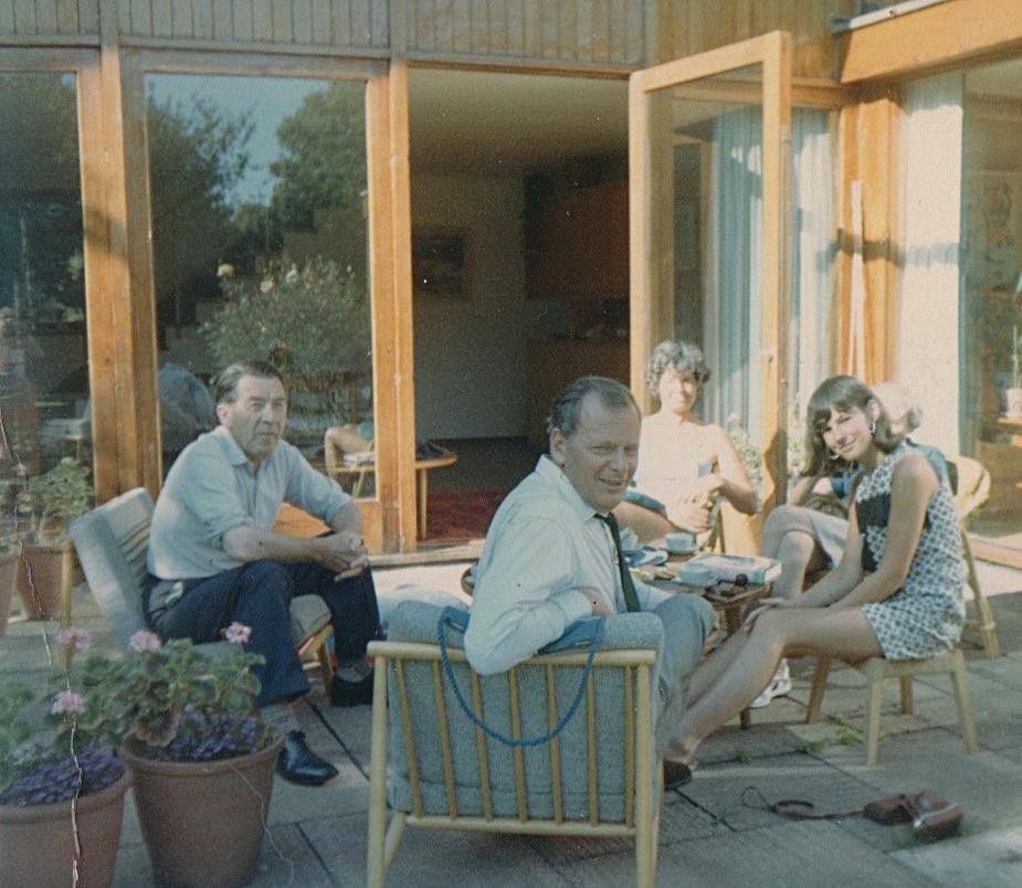 Mr Reid far left, Mrs Reid far right, and Ingrid sporting white lipstick and hoop earrings