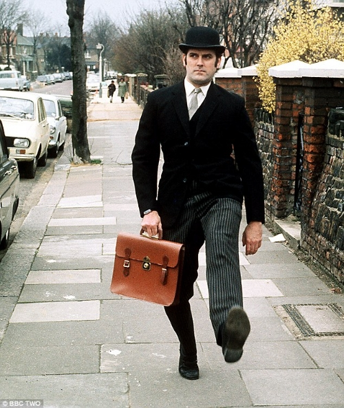 The bowler hat was inextricably linked to the 'city gent' and I remember the trains to and from London teemed with them. Hence John Cleese in Monty Python's 'Ministry of Silly Walks' (1970)