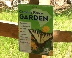[Image Description] A Carolina fence garden sign.