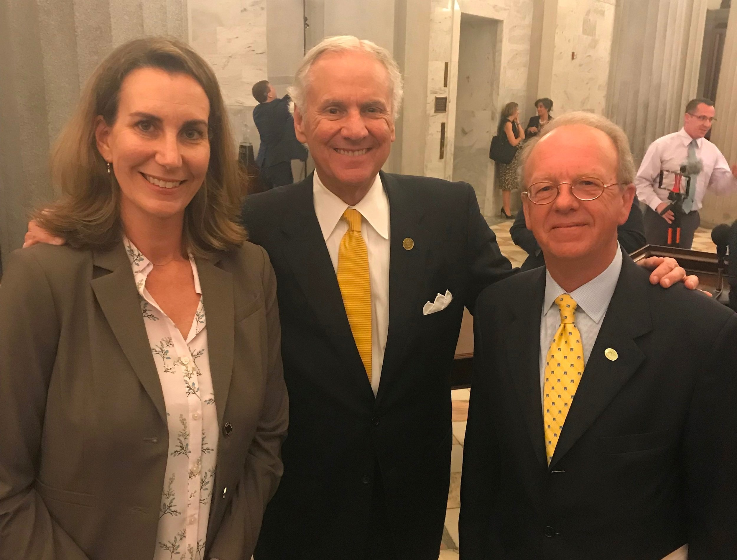 SCWF Executive Director, Sara Green, and SCWF Government Relations Manager, Trip King, stand with Governor Henry McMaster after he signed the Energy Freedom Act on May 16.