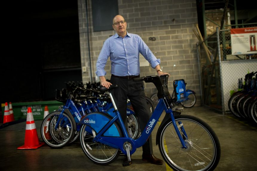 Jay Walder stands with a Citi Bike. (Photo by Alan Chin)