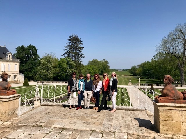The Wine and Design team overlooking the gardens of Château Beychevelle running down to the Garonne Estuary.