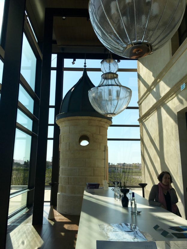 The glass tasting room of Château Pedesclaux including the dovecote and spectacular Murano chandeliers