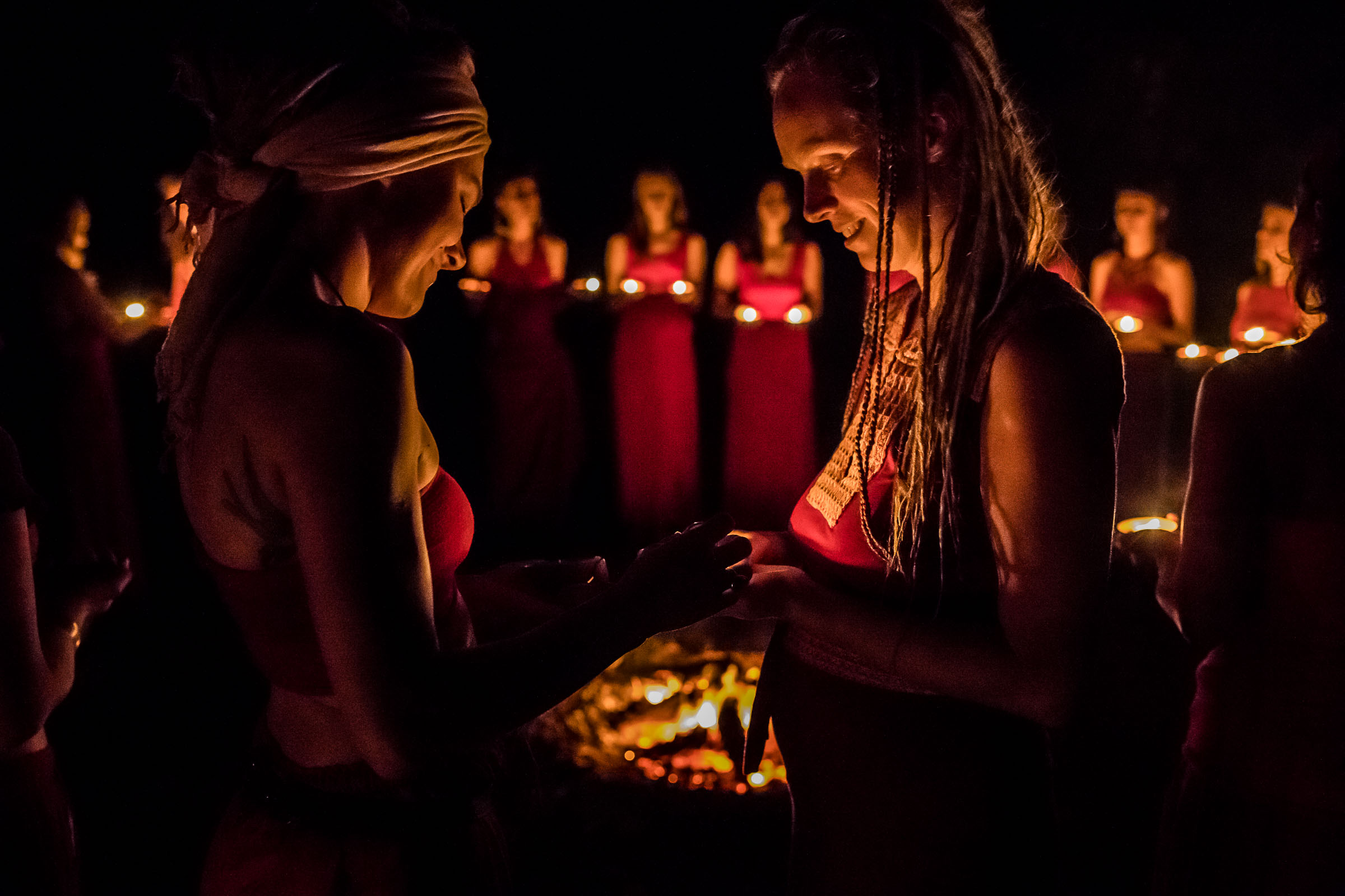 Women circle over the fire, Retreat ceremony capture by Portrait Photographer